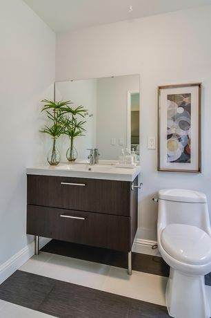 Contemporary Powder Room with Limestone counters, Undermount sink, Takla Porcelain Tile - Hollywood Road Series - Made in USA
