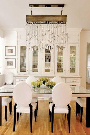 Traditional Dining Room with Standard height, Built-in bookshelf, Pendant light, Laminate floors