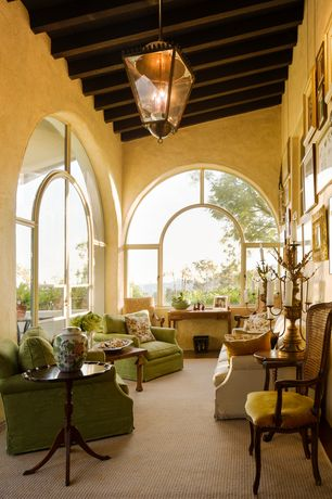 Traditional Living Room with Arched window, High ceiling, Exposed beam, Carpet, Clybourn Loft Armchair, flush light