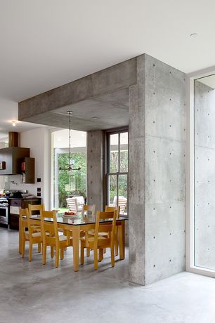 Contemporary Dining Room with Chandelier, Concrete floors, Polished concrete floors