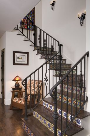 Eclectic Staircase with Wall sconce, Hardwood floors, Stained glass window