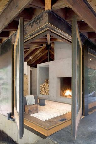 Contemporary Living Room with Concrete fireplace, Exposed beam, specialty window, Paint 1, Custom design, French doors