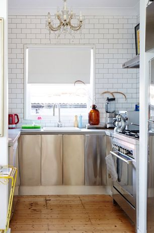 Eclectic Kitchen with Quartz counters, U-shaped, Wall Hood, full backsplash, Subway Tile, European Cabinets, Casement, Flush