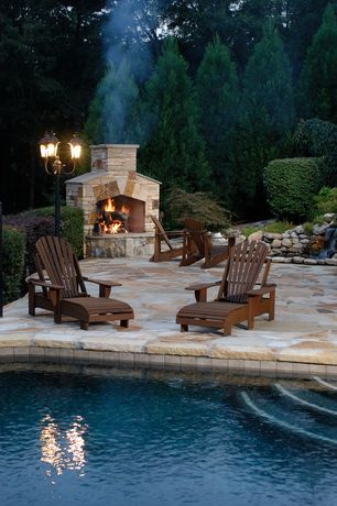 Traditional Patio with Stone outdoor fireplace, exterior concrete tile floors, exterior tile floors, Pathway