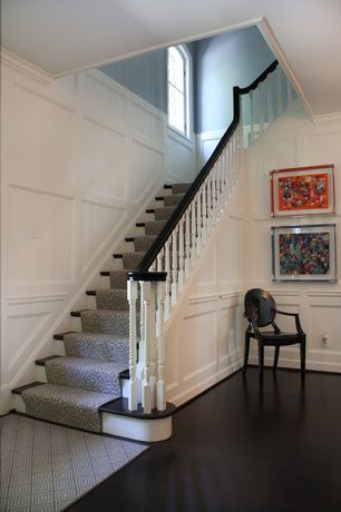 Traditional Staircase with Crown molding, High ceiling, Arched window, Wainscotting, Hardwood floors