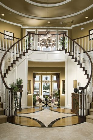 Traditional Entryway with Contrasting interior trim, Chandelier, simple marble tile floors, Crown molding, Paneling