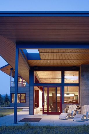 Contemporary Patio with exterior tile floors, Skylight, sliding glass door, picture window, Deck Railing, Transom window