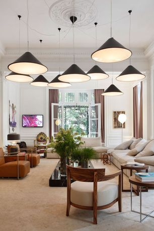 Contemporary Living Room with Standard height, picture window, Crown molding, Casement, Carpet, Wainscotting, Pendant light