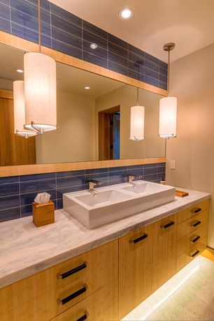 Contemporary Full Bathroom with Limestone Tile, Vessel sink, European Cabinets, Pendant light, Complex marble counters, Flush