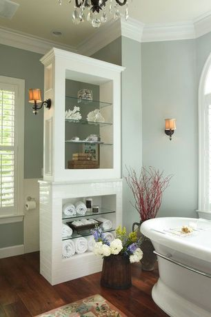 Traditional Master Bathroom with Freestanding, Daltile Natural Hues Ceramic Floor & Wall Tile, Arched window, Hardwood floors