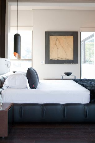 Contemporary Master Bedroom with Pipe Pendant By Tom Dixon, Built-in bookshelf, Pendant light, Zuri Dior Leather Bed