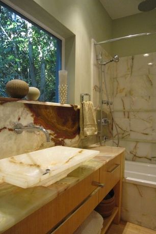 Contemporary Full Bathroom with Laminate floors, Onyx counters, Ms international multi green onyx, tiled wall showerbath