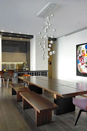 Modern Dining Room with Exposed beam, Columns, Chandelier, Hardwood floors