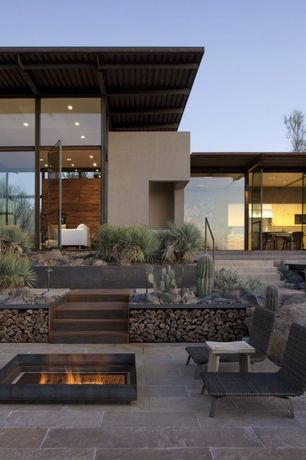Contemporary Patio with French doors, picture window, Fire pit, exterior stone floors