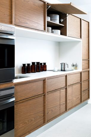 Contemporary Kitchen with Simple marble counters, Standard height, One-wall, double wall oven, Flat panel cabinets, Flush