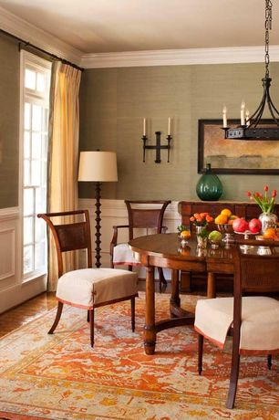 Traditional Dining Room with Chandelier, Crown molding, Wall sconce, Chair rail, Transom window, Hardwood floors