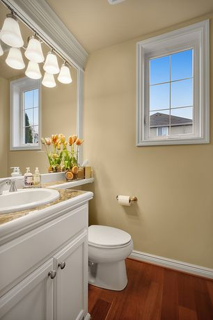 Traditional Powder Room with Hardwood floors, Casement, Standard height, Inset cabinets, Complex granite counters, Paint