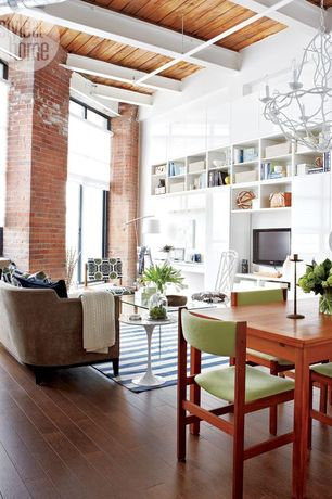 Contemporary Great Room with Hardwood floors, Transom window, Built-in bookshelf, picture window, Exposed beam, High ceiling