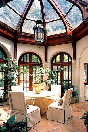 Traditional Dining Room with slate floors, Pendant light, French doors, Upholstered dining chair, Exposed beam, High ceiling