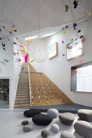 Eclectic Playroom with Carpet, Climbing wall feature, Ronel Jordaan Rock Cushion Hand Felted Merino Wool, Pendant light