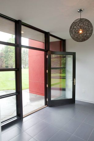 Contemporary Entryway with High ceiling, Transom window, soapstone tile floors, French doors, Chandelier