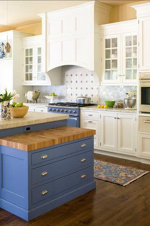 Country Kitchen with Wood counters, warming oven, Flat panel cabinets, Pendant light, Inset cabinets, Custom hood, One-wall