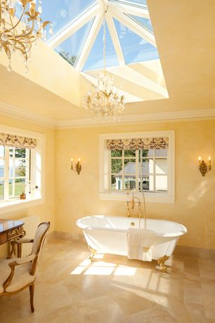 Traditional Master Bathroom with Skylight, Clawfoot, Paint, stone tile floors, Standard height, Bathtub, Casement, Chandelier