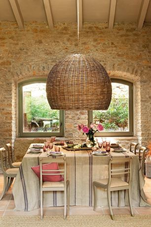 Eclectic Dining Room with sandstone tile floors, High ceiling, Pendant light, Custom graypants scraplight, Exposed beam