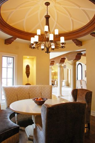 Mediterranean Dining Room with Mission concave corbels, Corinthian capital, Chandelier, Potterybarn silvia pedestal table