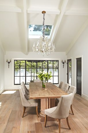 Traditional Dining Room with Wall sconce, French doors, Chandelier, High ceiling, Exposed beam, Hardwood floors, Skylight