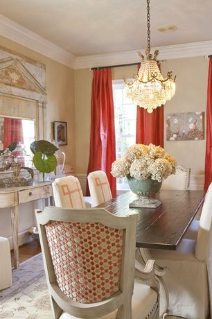 Traditional Dining Room with Crown molding, Hardwood floors, Wainscotting, Chandelier