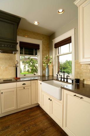 Country Kitchen with Soapstone counters, Flat panel cabinets, Farmhouse sink, Subway Tile, L-shaped