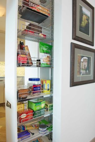 Modern Pantry with Lowes- rev a shelf wood pull out cabinet, Hardwood floors, Standard height