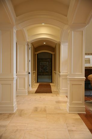 Traditional Hallway with six panel door, Wainscotting, Paint, Standard height, Crown molding, can lights, Exposed beam