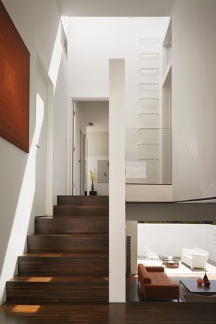 Contemporary Staircase with High ceiling, Laminate floors