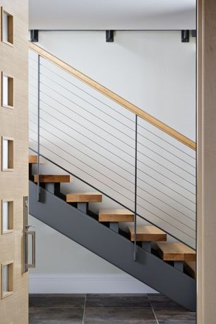 Contemporary Staircase with Hardwood floors, Glass panel door, Metal staircase