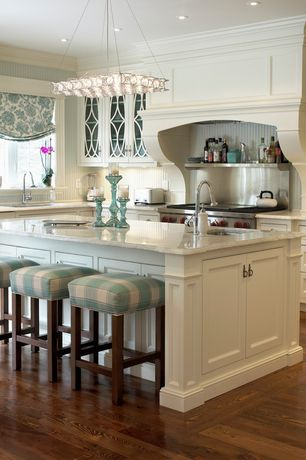 Traditional Kitchen with full backsplash, Standard height, Paint 1, Carrara marble countertop, Complex marble counters, Flush