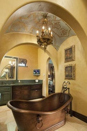 Mediterranean Master Bathroom with Wall sconce, Freestanding, Simple granite counters, Undermount sink, Cathedral ceiling