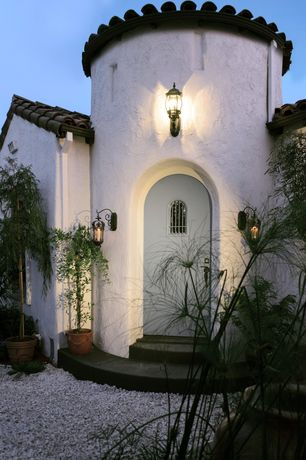 Mediterranean Entryway with specialty door, Pottery Barn Case Indoor/Outdoor Sconce, Tile roof, Concrete floors, Wall sconce