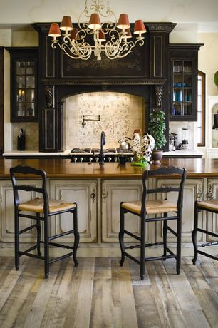 Country Kitchen with Chandelier, Wood counters, Glass panel, Inset cabinets, Pottery barn isabella barstool, Breakfast bar