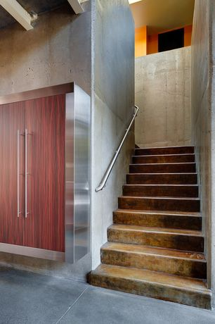Contemporary Staircase with Concrete floors, High ceiling, curved staircase