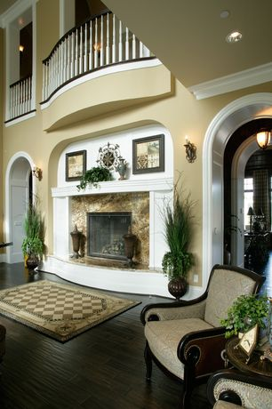 Mediterranean Living Room with stone fireplace, High ceiling, Balcony, Hardwood floors, Crown molding, French doors