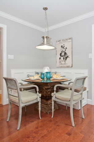 Traditional Dining Room with Crown molding, Paint, Wainscotting, Laminate floors, Dry-Dock Pendant, Standard height