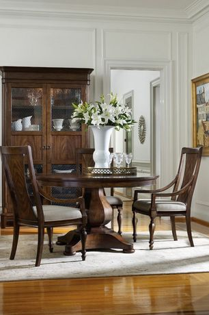 Traditional Dining Room with Hardwood floors, Crown molding, Standard height