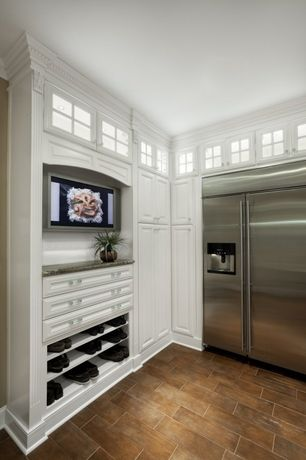 Traditional Kitchen with Glass panel, L-shaped, stone tile floors, Raised panel, Standard height, Built In Refrigerator