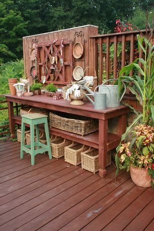 Eclectic Landscape/Yard with Vintage green painted stool, Vintage watering cans, Wicker baskets