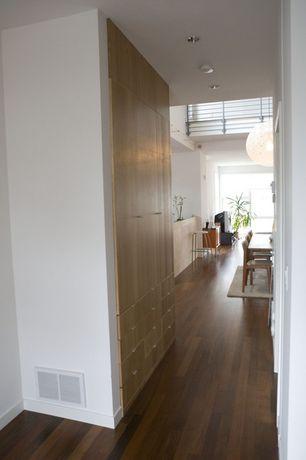 Contemporary Hallway with Built-in bookshelf, Hardwood floors