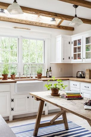 Country Kitchen with European Cabinets, Glass panel, U-shaped, Pendant light, Wood counters, Raised panel, Kitchen island