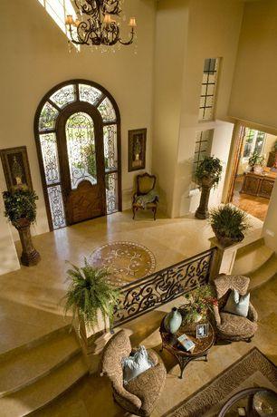 Traditional Entryway with Sunken living room, High ceiling, Chandelier, Glass panel door, travertine tile floors