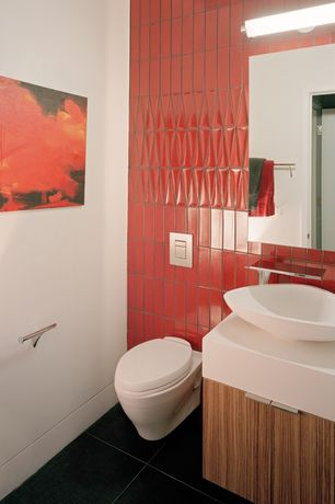 Contemporary Powder Room with Corian counters, Large Ceramic Tile, European Cabinets, Vessel sink, Flush, Powder room